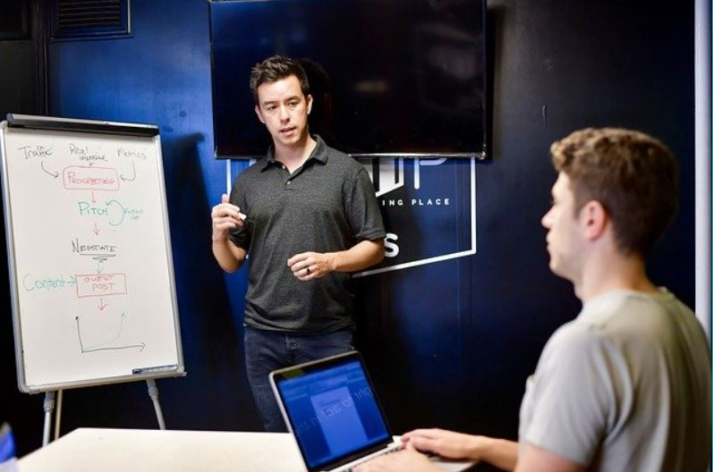 Photo of an employee gaining cybersecurity knowledge from a trainer