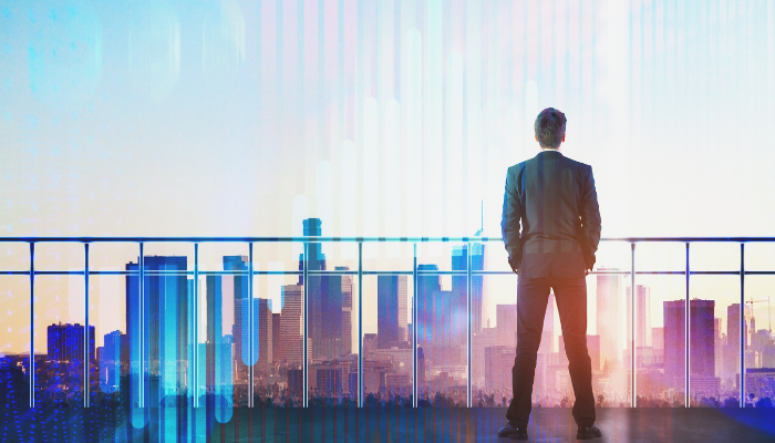 Photo of a back view of a young businessman on rooftop with business chart hologram
